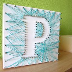 Do your own initial in a box with thread and nails. Could be something fun for the kids to do this summer.