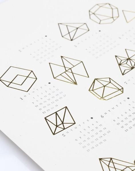 2014 Prisms Calendar - This unique calendar features geometric line drawings inspired by prisms. The drawings are printed in gold foil with complementing letter pressed text in black ink.