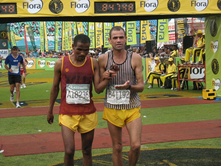 Blind runner and his guide crossing the finish line at the Comrades Ultra Marathon, Durban, South Africa, Comrades