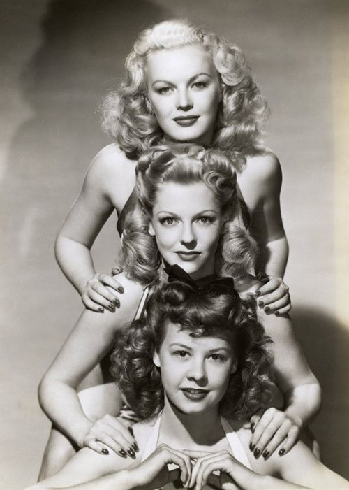 i love how they have a mess of curls; they don't have to be perfectly placed all the time. June Haver, Vivian Blaine, and Vera-Ellen, 1940's