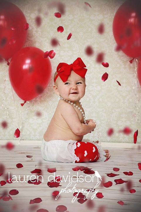 Unique and cute six month half birthday photos. Pictures for 6 month session. Ideas for little girl 3 months, 6 months, 9 months, 1 year, 2 year, toddler photo session. Vintage style session with banner. Flower petal props. Valentines Day picture ideas. Valentine's mini session prop ideas. Little girl pearl necklace shoot. Lauren Davidson photography.