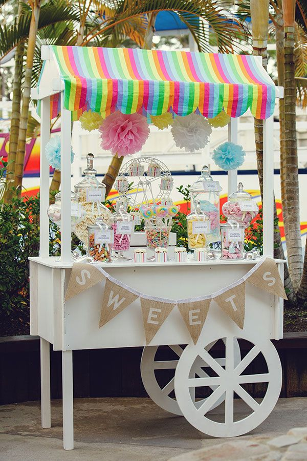 Homemade bunting by Anita Orr, the perfect addition to this gorgeous sweets cart. Photographer Andrea & Lani at Sproxton.