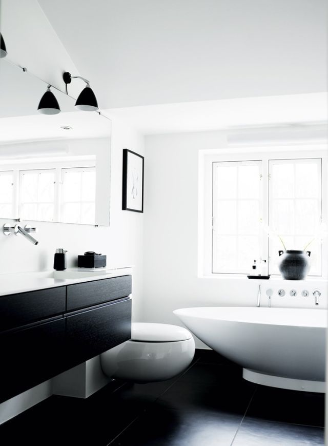 The beautiful simplicity of this black and white bathroom is accented by modern design www.remodelworks.com