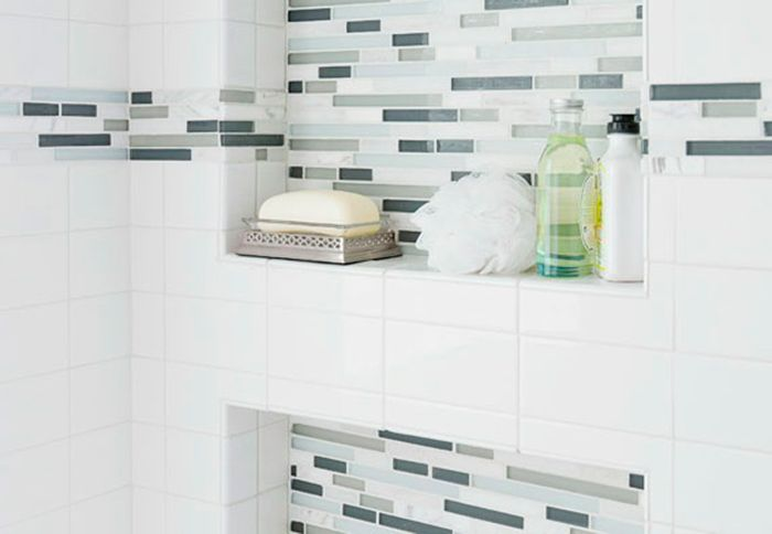 Inside the shower, built-in niches add storage and style. The two niches were carved out between the wall studs and dressed up with glass mosaic tiles (#291236). The sills are the perfect depth for housing bottles and soaps. lowes.com