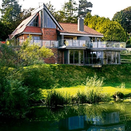 award-wining, architect-designed four-bedroom detached house, on the banks of the River Stour in Sturminster, Newton Dorset, UK