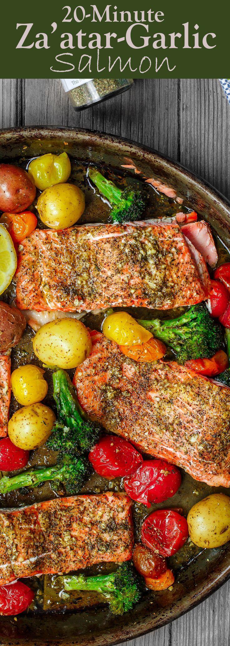 Za'atar Garlic Salmon Recipe | The Mediterranean Dish. Pan sheet garlic salmon with a Mediterranean twist you will love! Crusty zaatar, lemon juice, olive oil and veggies all on one sheet. Ready in 25 minutes! See the recipe on TheMediterraneanDish.com