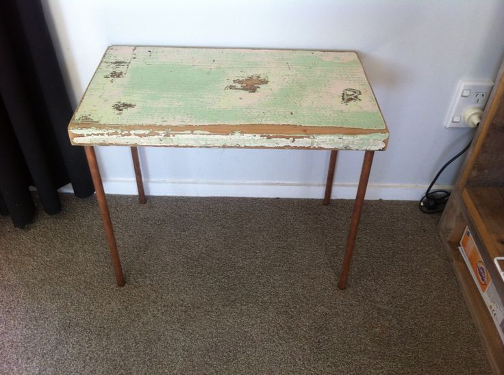 Kauri side table with copper pipes for the legs