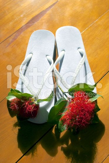 Jandals with Pohutakawa Flowers royalty-free stock photo