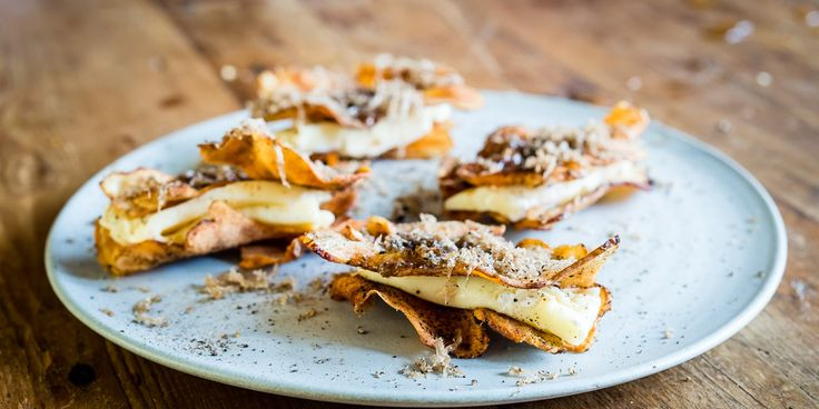 A wonderful Christmas canape recipe from Robin Gill, with creamy brie, earthy truffle and crisp Jerusalem artichokes. This delicious truffle recipe makes the perfect elegant party snack.