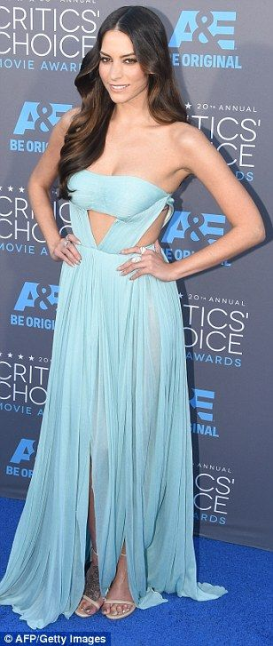 Blue and peachy: Genesis Rodriguez and Carmen Ejogo brought some pastels to the arrivals l...