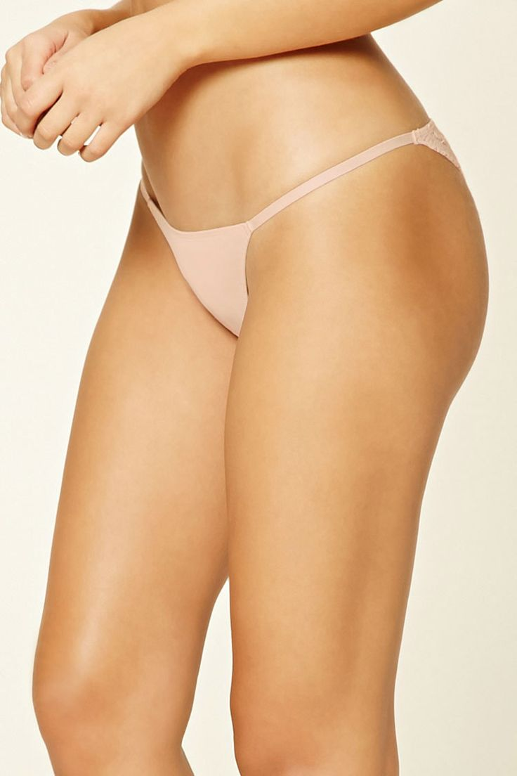 A microfiber knit bikini panty featuring a scalloped eyelash lace design on the back and strappy sides.