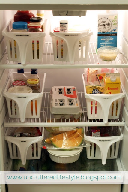 Organized Refrigerator using walmart baskets with handles. and what's even funnier, her fridge looks to be the exact same one we have, so i know it will work!!