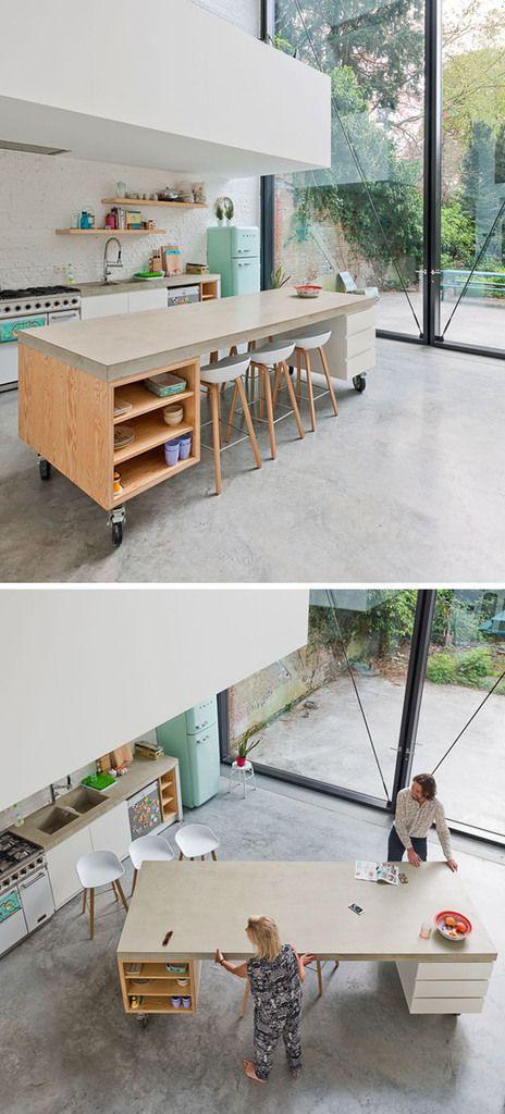 Дерево и бетон этого мобильного кухонного острова отлично вписываются в эклектичный интерьер кухни.  (кухня,дизайн кухни,интерьер кухни,кухонная мебель,мебель для кухни,индустриальный,лофт,винтаж,стиль лофт,индустриальный стиль,современный,интерьер,дизайн интерьера,мебель,эклектика,смешение стилей) .