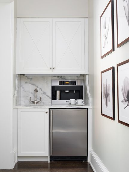 """Pretty """"X"""" detail on the cabinets and love the indulgence of a built-in espresso/coffee machine"""