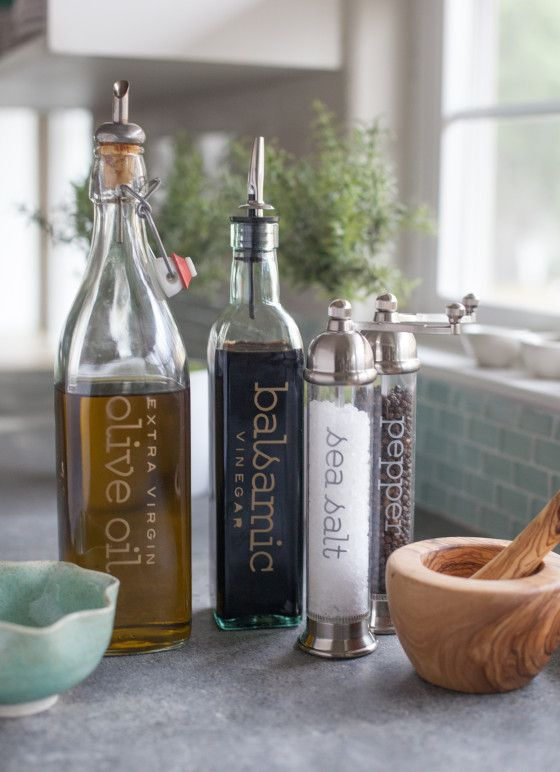 Use your favorite font to make sure your bottles of oil and vinegar stand out on your counter and fit your decor. Blogger Lia Griffith made these classy bottles using transfer sheets and a Cricut Explore. - HouseBeautiful.com