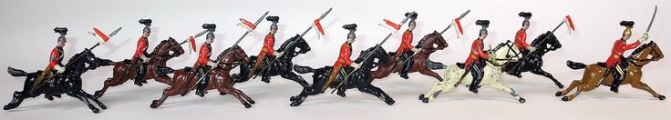 16th Lancers.    Very early, unnumbered set.  This is a full 9 piece set. 7 troopers, trumpeter, and officer. Smaller than standard size figures.  1893.  In 1895, 16th Lancers at the halt were issued as set 33.