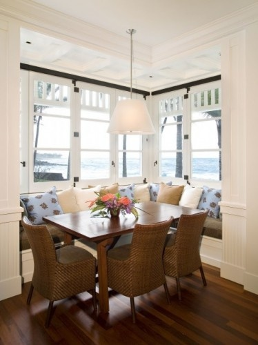 Kitchen nook/booth is great in a corner with windows, but can also be placed in middle of room if necessary to fit it in.