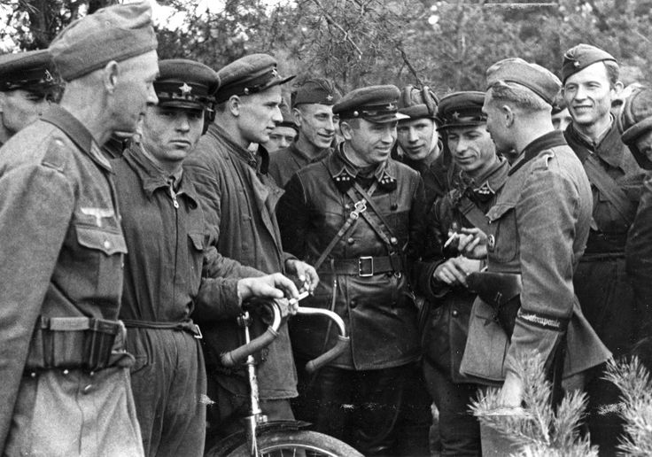 """Friends"" soon to be bitter enemies: German and Soviet troops meet during the German-Soviet invasion of Poland in Sept 1939. Berlin and Moscow divided Poland among themselves. In less than two years after this photo was taken, the Wehrmacht rolled across the Soviet frontier."