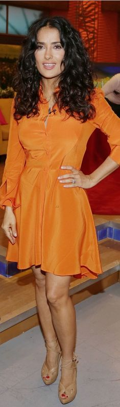 Who made  Salma Hayek's long sleeve button down orange dress that she wore in Miami on July 8, 2013?