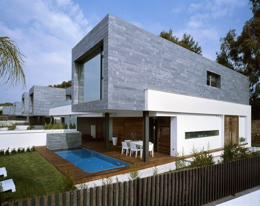 Six Semi-Detached Houses + Isolated House in Rocafort,© Diego Opazo