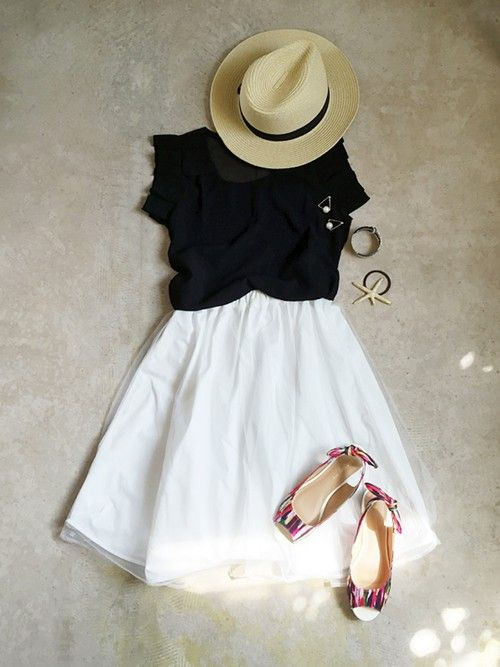 White (eyelet) skirt or dress worn with black  ruffled top. Leather sandals or wedges or ballet flats and fedora