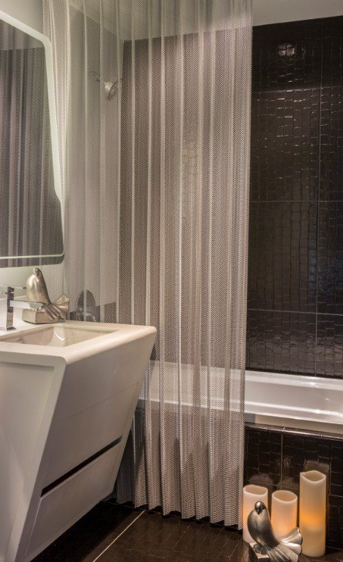 Mesh Shower Curtain - Cascade Coil-How does this work? Like a rain chain, the water trickles down. No mildew or smell.