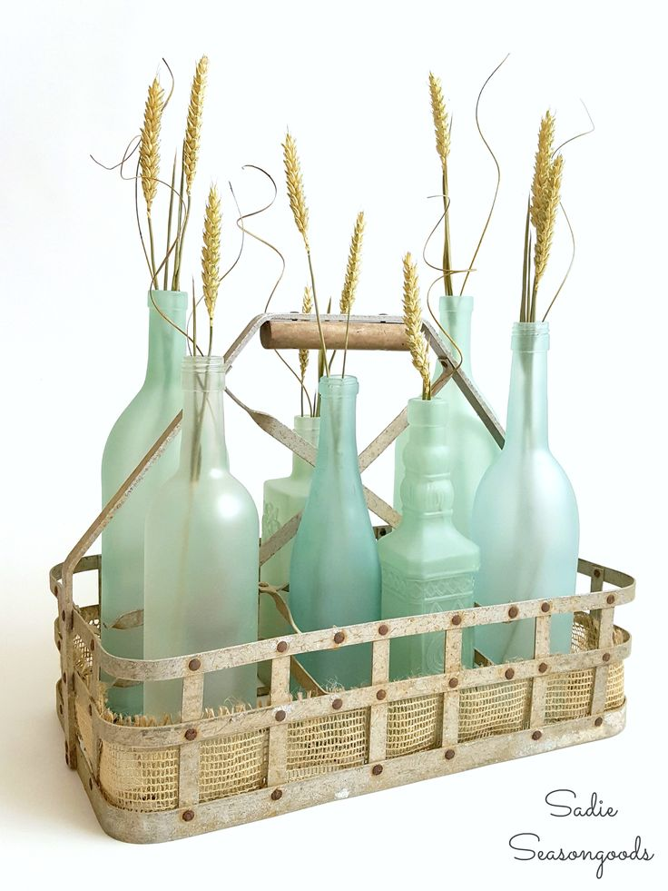 Repurpose your wine and liquor bottles from the recycling bin by transforming them into gorgeous sea glass coastal beach decor for…