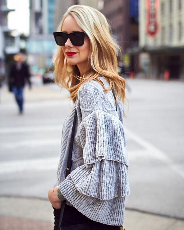 Grey knit sweater with ruffled sleeves and crisscross design on the shoulders. Looks comfy for those chilly spring nights.