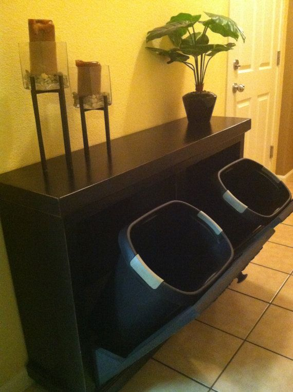 Double wooden garbage bin/laundry hamper. $154.99, via Etsy. ----Who wants to look at their trash receptacle? Not me