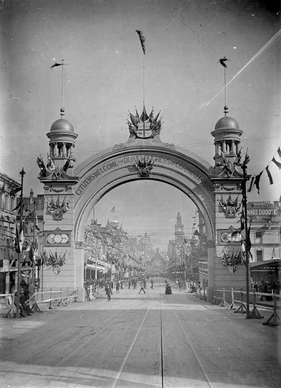 1901 To celebrate Federation & the royal visit of the Duke & Dutchess of Corwell, 9 temporary Arches were built in Melbourne. This view looking West down Bourke St.