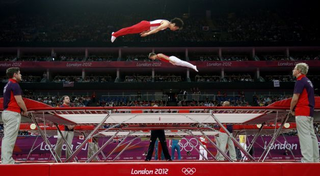 Gymnasts train before the men's trampoline final of the artistic gymnastics event of the London ...