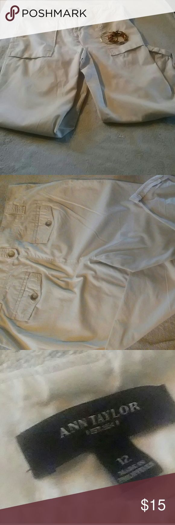 Ann Taylor Capri pants Ann Taylor Capri pants, size 12. Off white colored with cuffed and buttoned leg bottoms. Super comfortable and will leave you looking all spring and summer. Great for Friday dress down day at the office or pair with cute sandals for window shopping on a Saturday. Ann Taylor Pants Capris