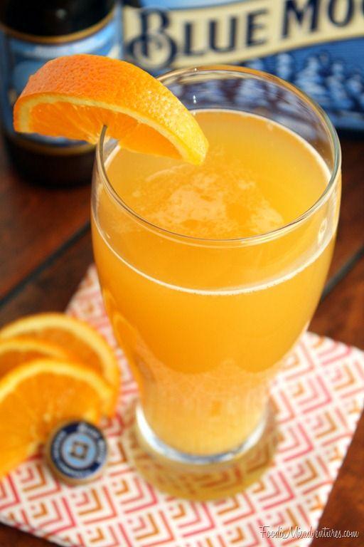 Citrus Cocktale   1(12 oz) bottle of wheat beer, such as Blue Moon  1 shot (1.5 oz) citrus flavored vodka  ½ shot (0.75 oz) Grand Marnier or orange liqueur  ¼ cup Orange juice  Orange slice for garnish (optional)