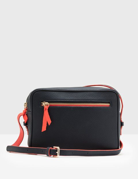 Whether you're making a weekend getaway or a quick trip into town, this cross-body bag is ideal for holding your essentials. On the outside you can choose from soft leather, statement pony or strokeable shearling, then inside you'll find a fun spot print and ultra-handy pockets for your phone and cards.
