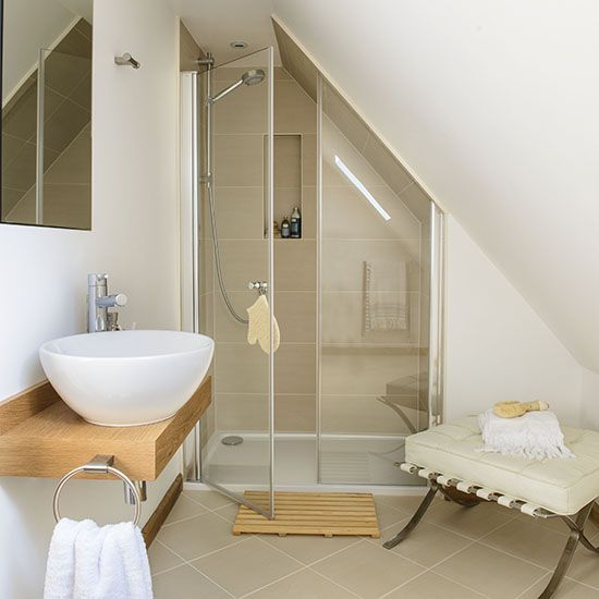 Loft shower room, with white walls, neutral tiles, walk-in shower and white basin