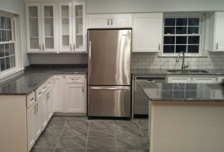 White cabinets with new Caledonia granite, a medium grey, and subway