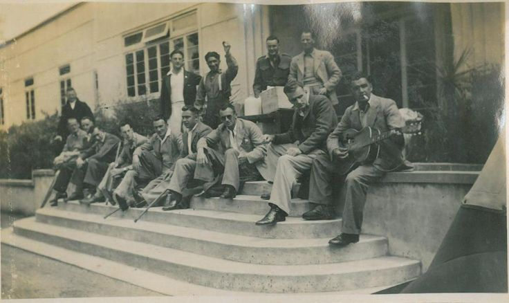 This is a group of patients on the front steps of the Services Convalescent Hospital now known as QE Spa.  You can see this photo and many more from the photo album of Kay Taylor on Kete Rotorua
