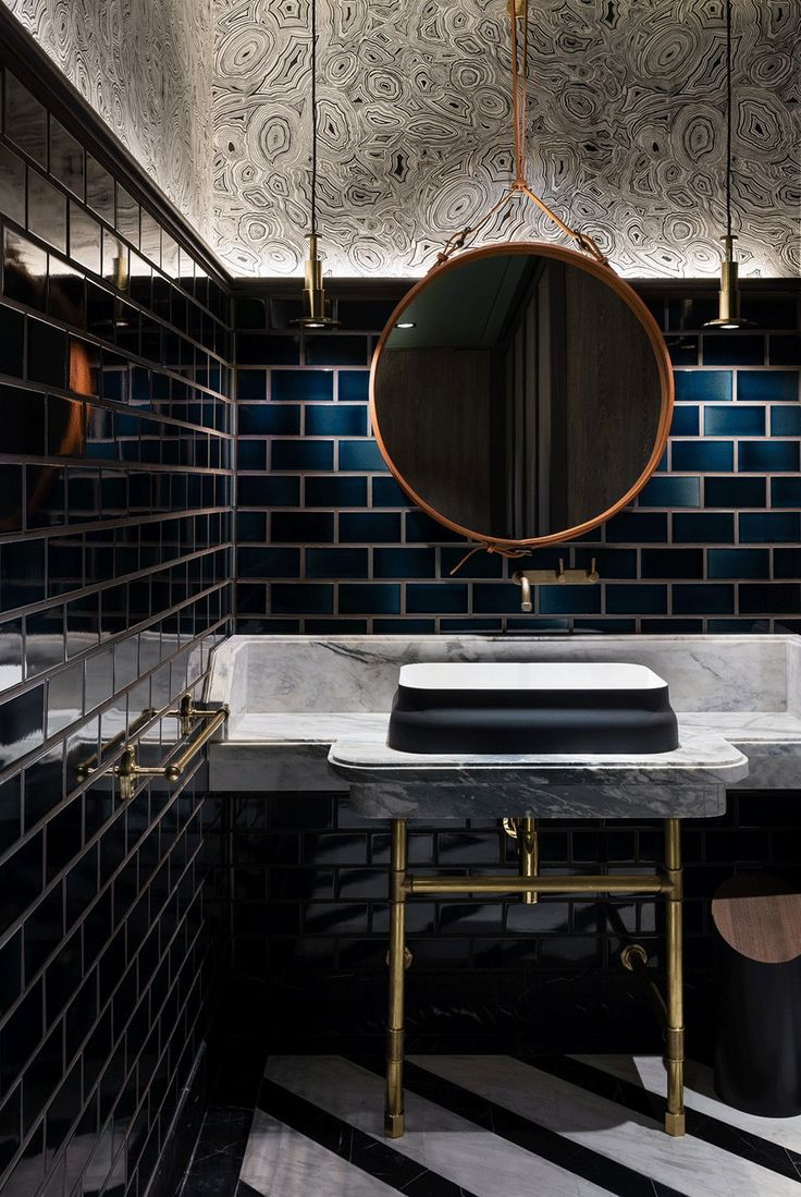 Two Tom Dixon COG Pendants Light This Hong Kong Bathroom Aged Italian Brick Tiles Blacken Steel I Beams And Cement Panels Throughout Complete The Retro