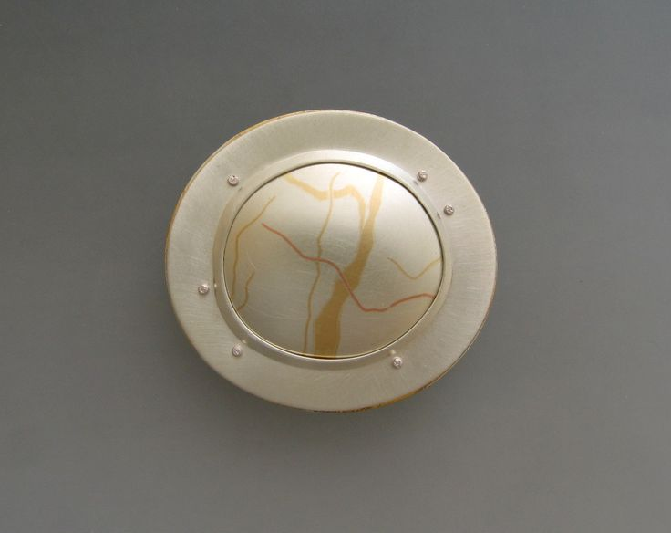 """""""Pebble Series""""; Married Metals [sterling, copper, bronze, 18K gold]; sterling setting with sterling rivets."""