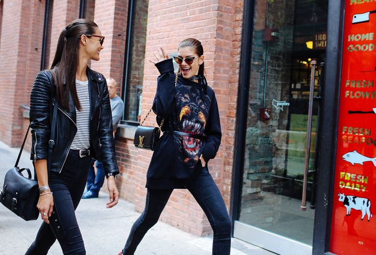 Anja Leuenberger and Marta Ortiz in a Givenchy sweatshirt and with a Louis Vuitton bag: