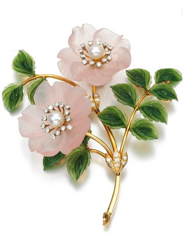 A gem set and diamond brooches, circa 1960  A brooch designed as a spray of wild roses, set with carved nephrite and rose quartz, each flower head set with a cultured pearl and brilliant-cut diamonds.