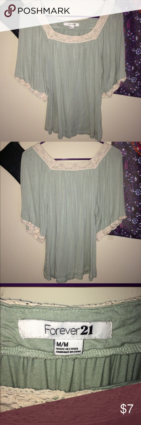 Forever 21 green w/ cream lace top Good condition-lightly worn. No rips snags or stains. From a smoke free environment. Size M but can fit size S Forever 21 Tops Blouses