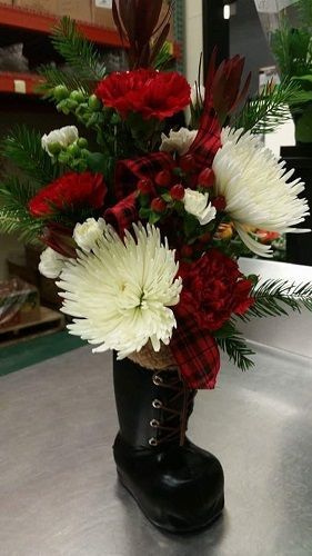 Thanks to our customer Kathy at Festival Foods for sharing this photo using our Santa Work Boot Vase! Thank you to our customer Kathy at Festival Foods for sharing this photo! The floral arrangement using our Santa Work Boot Vase (http://goo.gl/ch6K0y) looks gorgeous!