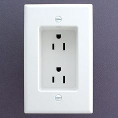 Note to self...if you ever build or remodel - use recessed outlets so that the plugs don't stick out from the wall. This allows furniture to be flat against the wall. Great idea!