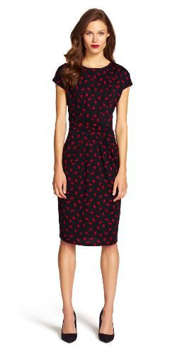 Printed cap sleeve dress Playful red birds adorn this figure flattering faux wrap dress, featuring a scoop neck and cap sleeves.