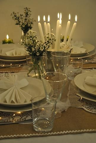 Very enchanting. Love the lace doilies for the place settings. The wee lights under the plates and the bucket with sand and all the candles.