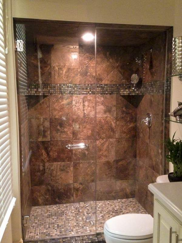 Walk-in Tile Shower Replaces Tub Shower ...I like that the tile completely…