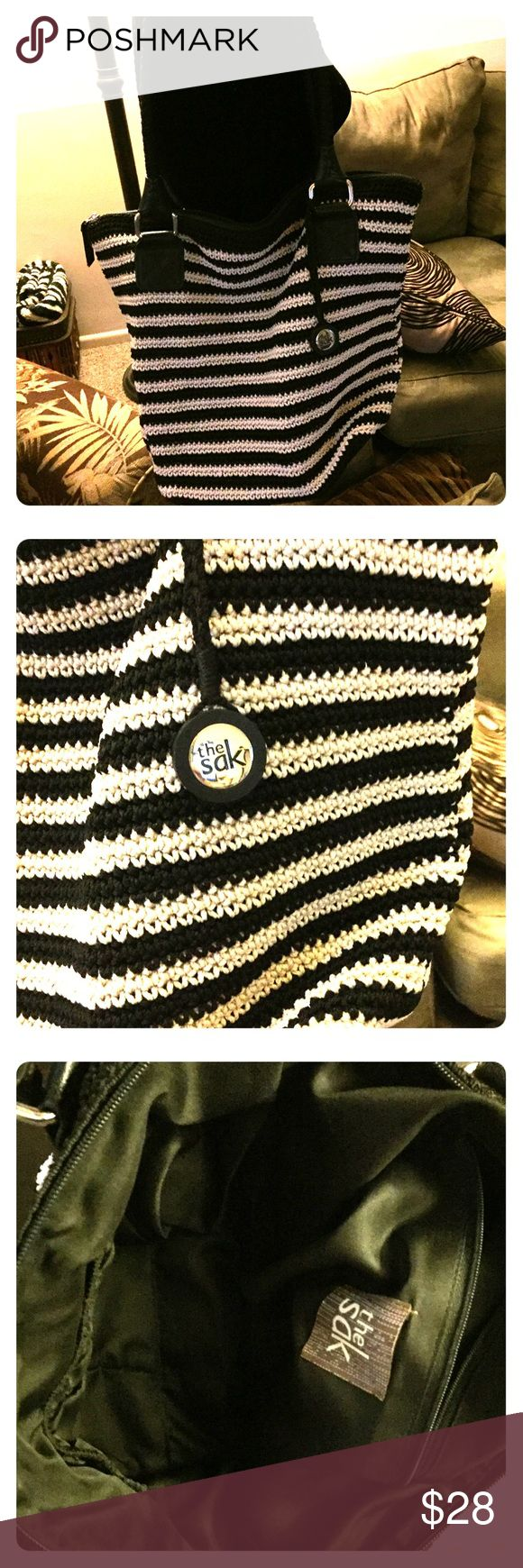 👜The SAK Purse The SAK Purse in black & white strips, perfect for summer, jeans, shorts.... Looks like new, great condition. The Sak Bags Shoulder Bags