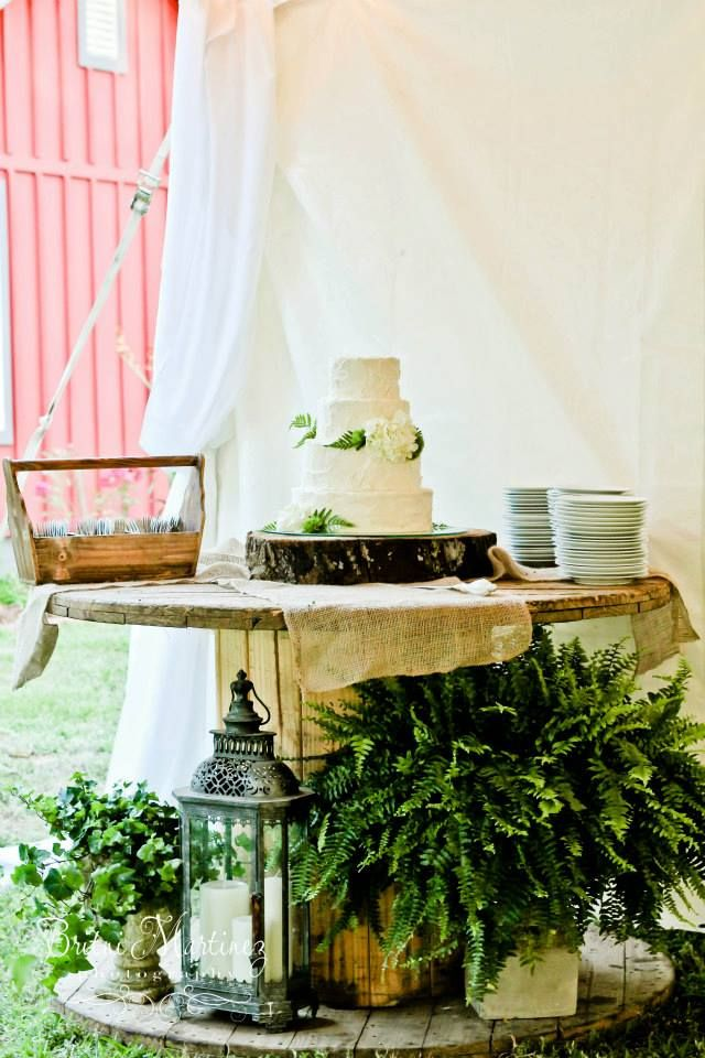 Large cable spool used as the wedding cake table at The Fritz Farm Wedding Venue in Cordele, GA