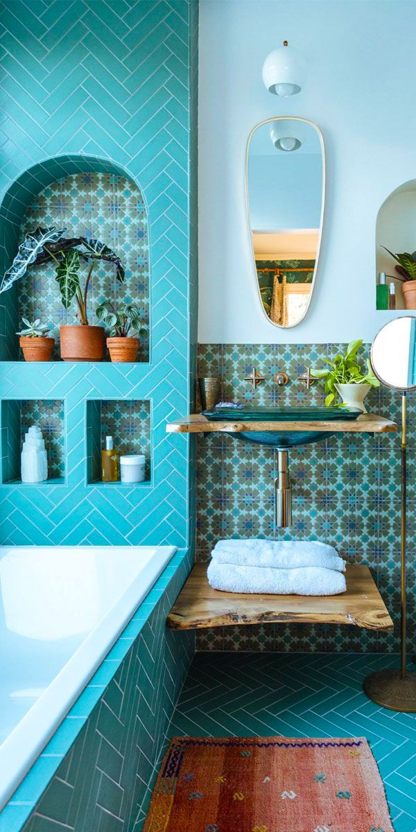 Turquoise and teal tile bathroom..a bit bohemian. Love it